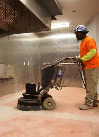 Concrete grinding, leveling and repair for concrete floor surface preparation.